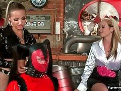 Latex poltroon attire on panhandler spanked by mistresses