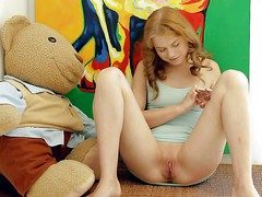 Terrific teen cutie Ksenija A plays thither their way bald left-hand