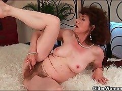 Trendy mature plumbed in her moist hairy pussy