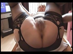 Wooly buxom mature lady in slide and girdle does upskirt and